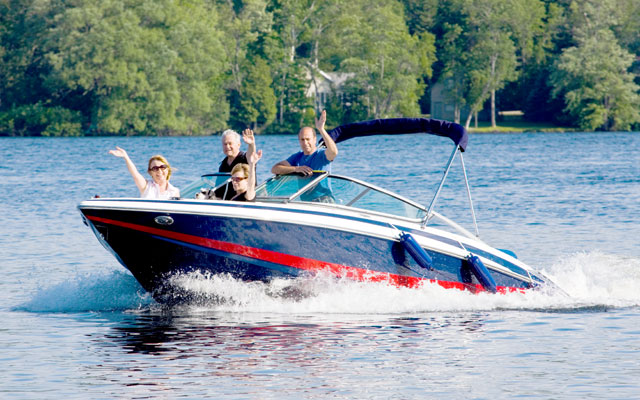 Boating on Kashagawigamog Lake in Haliburton, Ontario